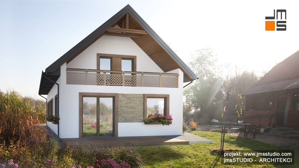 Projekt indywidualny małego domu na wsi w starym siedlisku o rustykalnym charakterze z ciekawą balustradą balkonową
