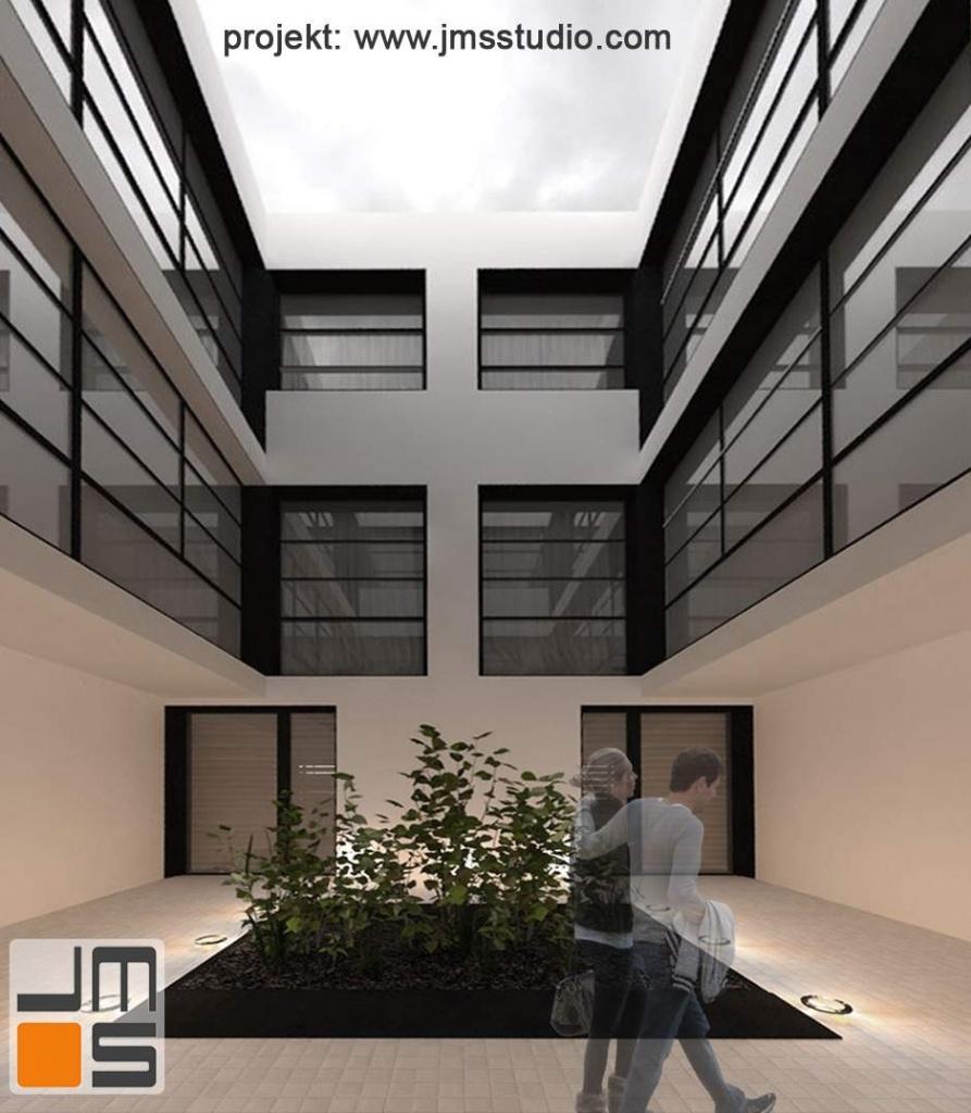 Architekt zaprojektował nowoczesny budynek w jasnej kolorystycze z odcieniami berzu i czarnymi antracytowymi dodatkami i elementami wykończeniowymi