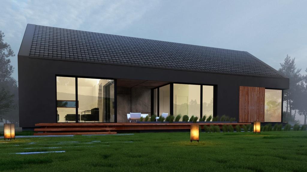 Duże przeszklenia wykonane na elewacji za pomocą stolarki aluminiowej otwieraja wnętrze nowoczesnego domu stodoła na ogród i górskie widoki.