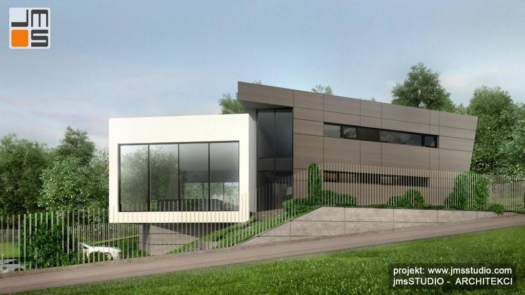 zabawa bryłami w nowoczesnym projekcie designerskiego budynku w szaro białej kolorystycze z płackim dachem Kraków