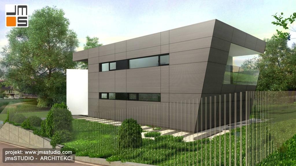Minimalistyczna elewacja w kolorze szarym od strony ulicy w projekcie nowoczesnego domu jednorodzinnego