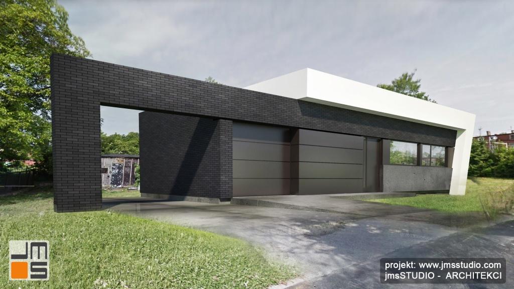 Beton architektoniczny, antracytowa cegła i biały tynk na prostej nowoczesnej elewacji domu jednorodzinnego w Tychach