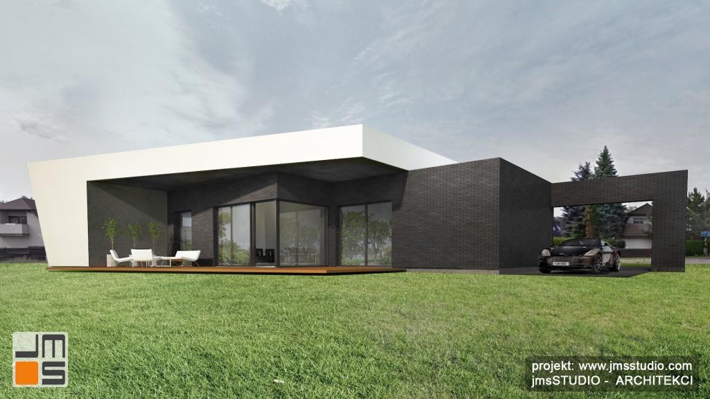 Uskoki ciekawym pomysłem na elewacje domu nowoczesnego w Tychach z dużymi oknami na elewacji z wyjściem na taras