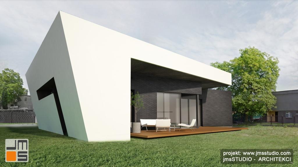Projekt nowoczesnego domu śródmiejskiego alternatywy do mieszkania w bloku w Tychach -projekt domu z dużymi oknami i prostą nowoczesną elewacją na małej działce w mieście