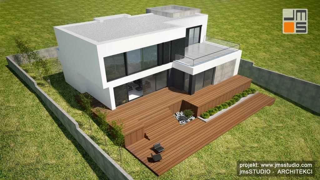 z góry dobrze widać tarasowy układ budynku nowoczesnego prostego domu na działce ze spadkiem terenu