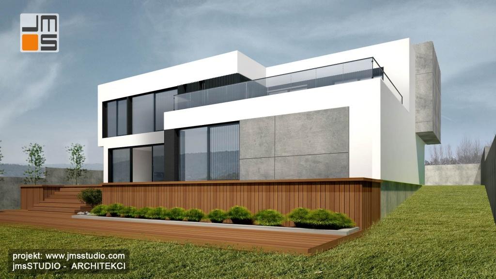 Bardzo duże przeszkleniaw nowoczesnym projekcie domu pod Krakowem są ważnym elementem projektu elewacji