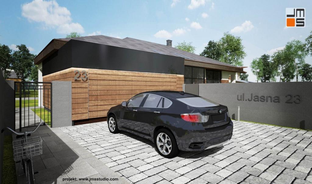 W projekcie willi zastosowano rozwiązanie polegające na wydzieleniu strefy podjazdu od strefy ogrodowej za pomocą ogrodzenia z betonu architektonicznego