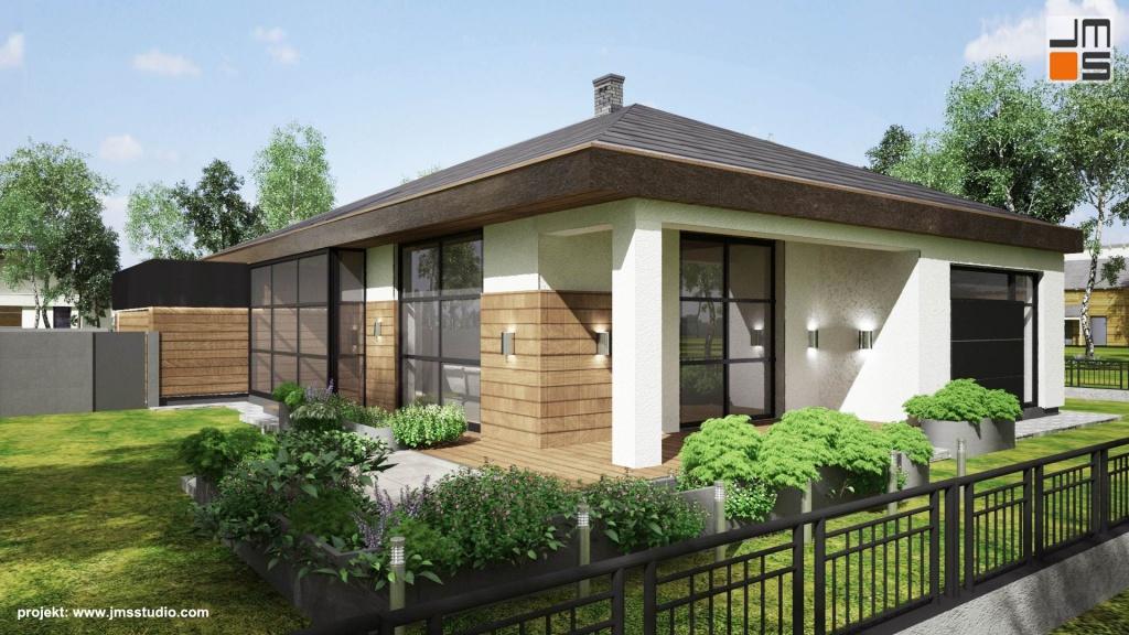 Od strony ogrodu w Willi pod Katowicami zaprojektowany został duży nowoczesny taras z zadaszeniem