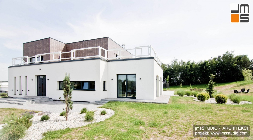 Architekt Kraków projekt dużego nowoczesnego prostego domu z pudełek brył prostych z płaskim dachem i tarasem okolice Poznania