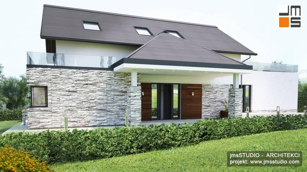 Kamień i drewno to dobry pomysł na elewacje klasycznego eleganckiego projektu domu pod Nowym Targiem