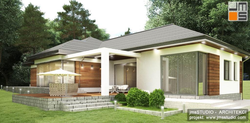 Projekt domu nowoczesnego z tarasem i atrium. W domu zastosowano drewno elewacyjne dla ocieplenia prostej jasnej elewacji