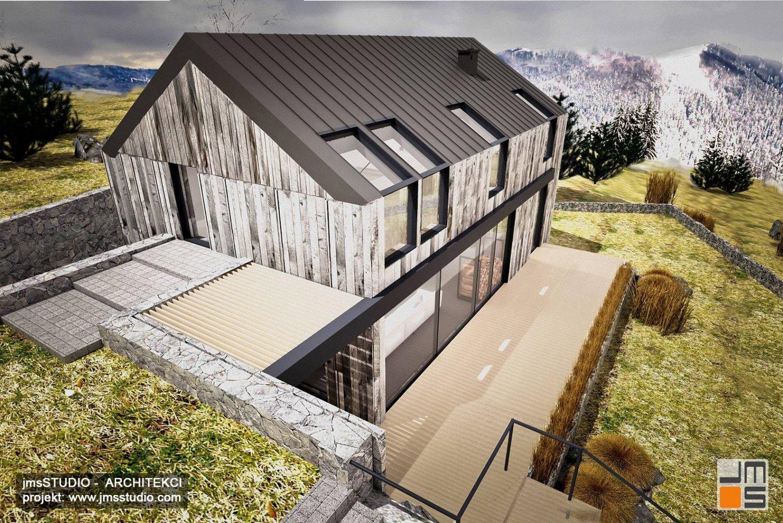 Projekt domu nowoczesna stodoła wykorzystuje spadek terenu a drewno na elewacji to pomysł na styl skandynawski