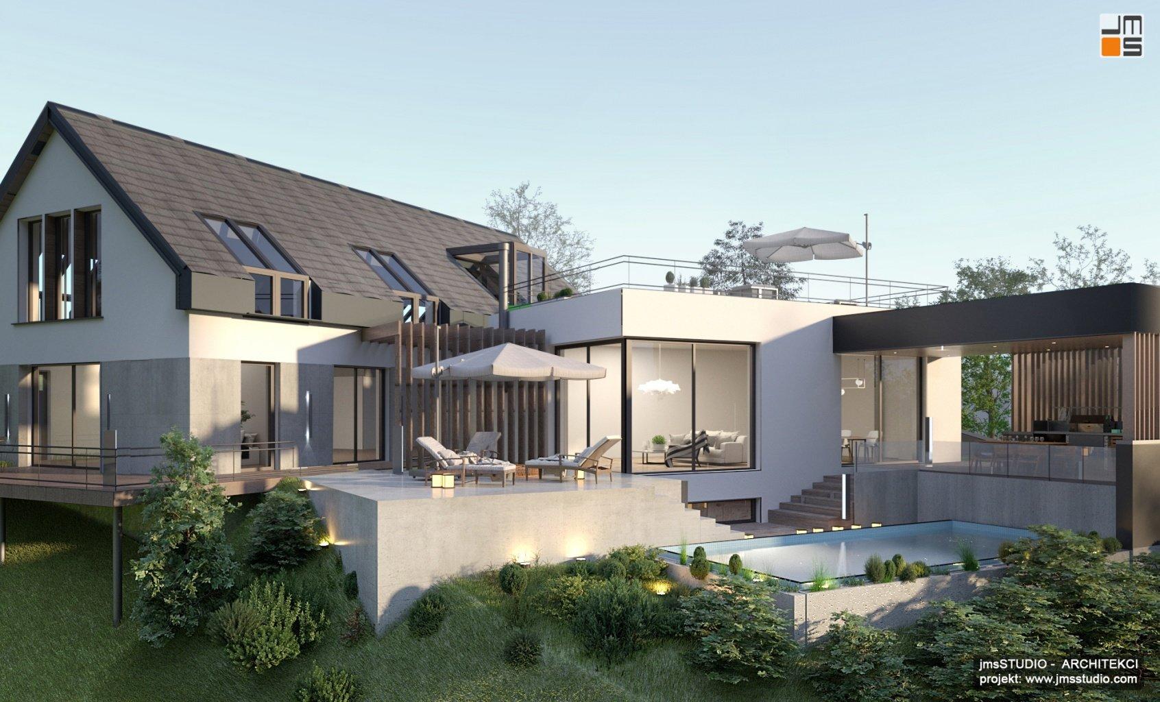 Nowoczesny projekt dużej rezydencji z basenem i kuchnią zewnętrzną - to piękny projekt dużego domu na trudnej działce ze spadkiem pod Krakowem