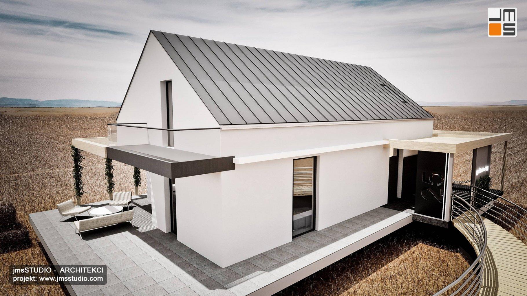 projekt domu modułowego z prostą elewacja w jasnych kolorach i ciekawym wejściem pomostem