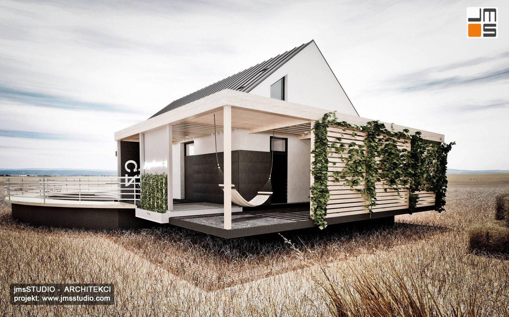 Architekt Katowice - Projekt nowoczesnego domu modułowego na wsi na Śląsku - elewacja z blachy na rąbek taras z pergolą i żaluzjami
