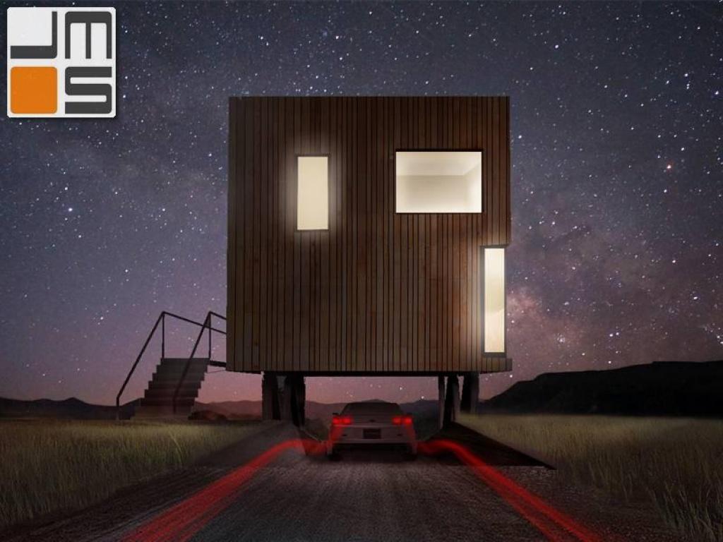 Ujęcie nocne dom kostka z kontenerów morskich dom z elewacją drewnianą